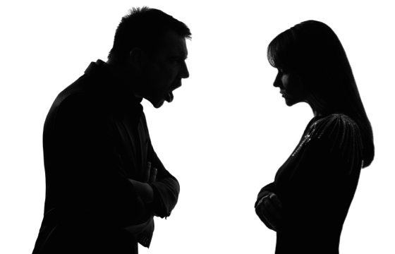 one caucasian couple man and woman face to face screaming shouting dipute in studio silhouette isola